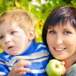 Portrait of a beautiful young mother and her little son on the n — Stock Photo