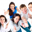 Top view of young friends showing thumbs up — Stock Photo