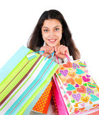 Portrait of an enthusiastic woman with packages in hands isolate — Stock Photo