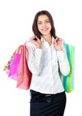 Portrait of a smiling young woman with packages in hands isolate — Stock Photo