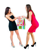Young attractive girl taken away from one another package with t — Stock Photo