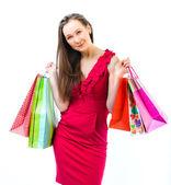 Jovem garota atraente com sacos de compras nas mãos isolados — Fotografia Stock