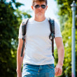 Young athletic man walks on a sunny day — Stock Photo