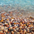 Pure transparent water and pebbles. sea ??texture — Stock Photo