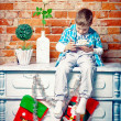 Stock Photo: Little boy sitting on dresser