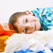 Little boy under the Christmas tree among the gifts — Stock Photo