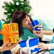 Young family with Christmas gifts — Stock Photo