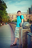 Young man looking into the distance on a walk — Foto Stock