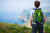 A guy with a backpack on the nature — Foto Stock