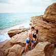Passionate young couple embracing near the seashore — Stock Photo