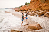 Young couple hugging near the sea shore — Foto Stock