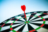 Dart on a board isolated — Stock Photo