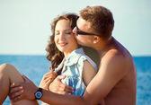 Pretty young couple near the sea — Stok fotoğraf