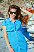 Portrait of a girl on the waterfront on the background of a yach — Stock Photo