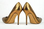 Pair of golden colored High Heel — Stock Photo