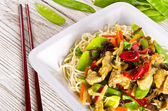 Noodles with pork and vegetables in plum sauce — Stock Photo