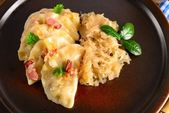 Pierogi.Polish dish pierogi with sauerkraut and mushrooms — Stock Photo