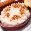Royalty-Free Stock Photo: Milk rice with cinnamon and applesauce