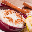Stock Photo: Milk rice with cinnamon and applesauce