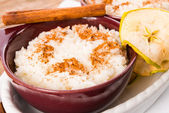 Milk rice with cinnamon and applesauce — Stock Photo