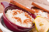 Milk rice with cinnamon and applesauce — Stock Photo