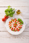 Tomato with mozzarella cheese — Stock Photo