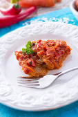 Fish in Greek kind with vegetables and tomato sauce — Stock Photo