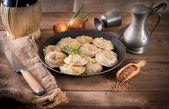 Pierogi with meat and buckwheat groats — Stock Photo