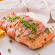 Salmon in the bacon coat — Stock Photo