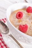 Oatmeal with fresh raspberry — Stock Photo