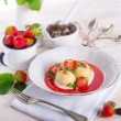 Dumplings with strawberries — Stock Photo #27428137
