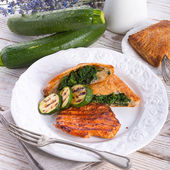 Grilled steaks with puff pastry bag and zucchini — Stock Photo