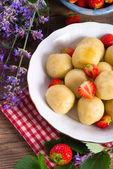 Dumplings with strawberries — Stock Photo