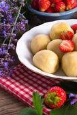 Dumplings with strawberries — Stock Photo