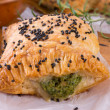Puff pastry with spinach filling and black cumin — Stock Photo
