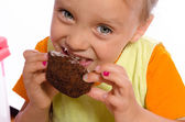 Small girl and muffin — Stock Photo