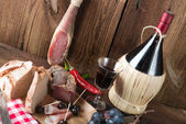 Ham, wine and bread — Stock Photo
