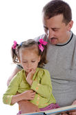 Father with daughter in read — Stock Photo