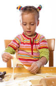 Small girls in cook — Stock Photo