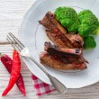 Stock Photo: Grilled ones rib with broccoli