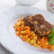 Ribs with carrots and maize — Stock Photo