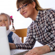 Stock Photo: Mother and daughter on computer