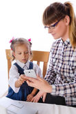 Mother and daughter with mobile phone — Stock Photo