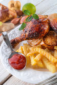 Chickens with French fries — Stock Photo