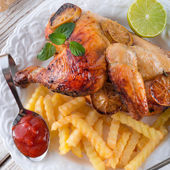 Chickens with French fries — Stockfoto
