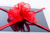 Tablet PC with ribbon — Stock Photo