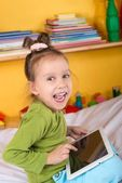 Small girl with tablet — Stock Photo