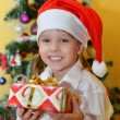 Small girl with presents — Stock Photo