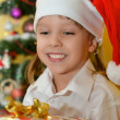 Small girl with presents — Stock Photo #38798853