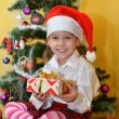 Small girls with presents — Stock Photo